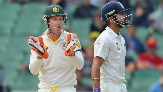 Brad Haddin exchanges words with Virat Kohli during day five of the third Test.