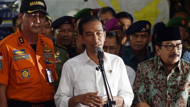 """We also feel the loss from this tragedy"": Indonesian President Joko Widodo (centre)."