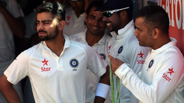 Passing the baton: Virat Kohli will take over the captaincy from MS Dhoni for the Sydney Test.