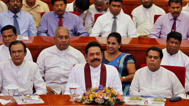 Sri Lankan President Mahinda Rajapaksa (centre) with his party members at the launch of his election manifesto in ...