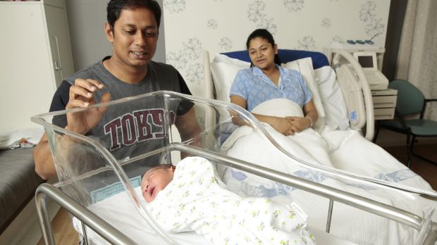 Mum Seethal Menon of Watson with partner Thomas George and their new baby boy Ronith born at 12:59am at the Centenary ...
