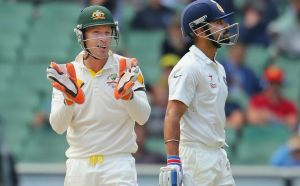 What you say?: Brad Haddin and Virat Kohli exchange words during the third Test at the MCG.