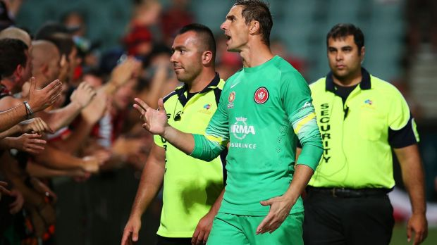 Show of support: Goalkeeper Ante Covic makes his point to the Wanderers faithful.