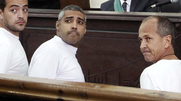 Al-Jazeera journalists Baher Mohamed, Mohammed Fahmy, and Peter Greste appear in court in March, 2014.