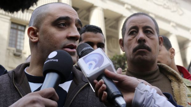 Adel, the brother of Mohamed Fahmy, speaks to the media in front of Egypt's highest court.