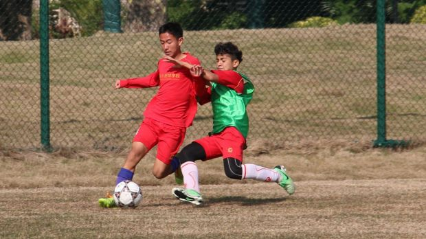 Next generation: Evergrande Football School(ESF) students train to be professional soccer players.