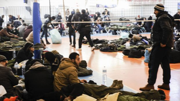 Asylum seekers at an ad hoc first aid centre after arriving in Italy aboard the Moldovan-flagged ship Blue Sky M this ...