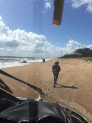 An RACQ CareFlight crew land at Baffle Creek as part of a search and rescue mission.