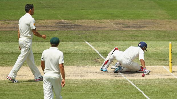 Virat Kohli falls to the ground after being hit by a throw from Mitchell Johnson during the Boxing Day Test.