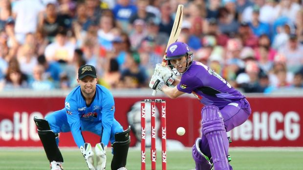 Hurricanes skipper George Bailey gets set for a big hit during his match-winning innings.