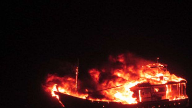 The four-person crew of a Pakistani fishing boat died after setting their craft alight following a high-speed chase with ...
