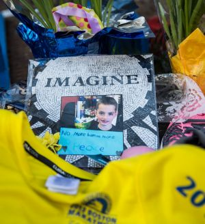 A photo of eight-year-old Martin Richard, who died in the bombing, near the finish line a year after the attack.