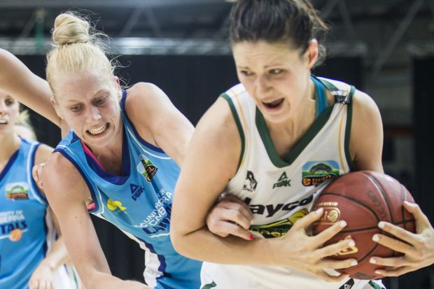 Abby Bishop of the Canberra Capitals fights for the ball.