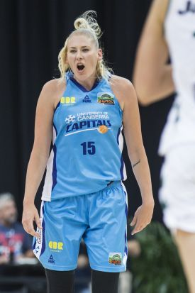 Lauren Jackson of the Canberra Capitals calls her team to defend.