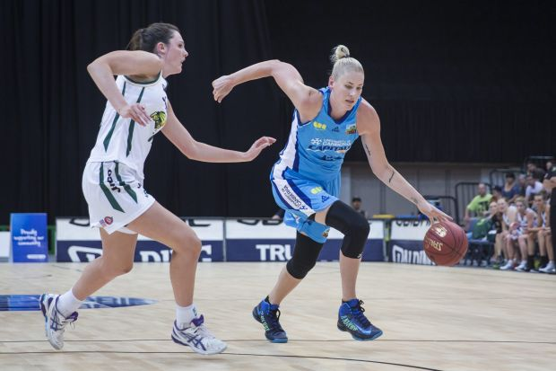 Lauren Jackson of the Canberra Capitals drives the ball forward.