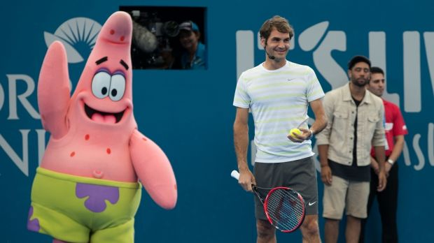 Roger Federer took to the court at the Brisbane International kids tennis day under the watchful gaze of Nickelodeon's ...