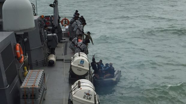 An Indonesian Navy seaboat picks up items retrieved from the Republic of Singapore Navy vessel RSS Valour.