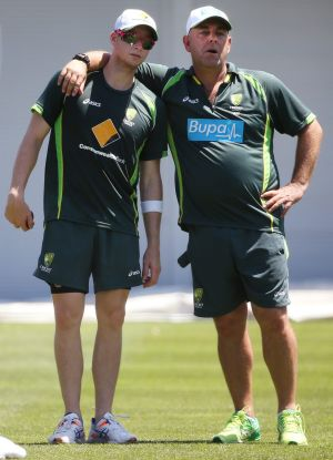 Together as one: Australian skipper Steven Smith and coach Darren Lehmann at training on Sunday.