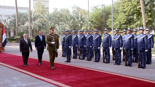 Iraqi Prime Minister Haider al-Abadi and Australian PM Tony Abbott walking on the red carpet during a welcoming ceremony ...