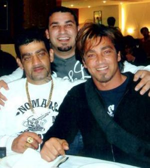 Michael Ibrahim, centre, who was shot in Macquarie Street on Sunday night, pictured with brothers Sam and John.