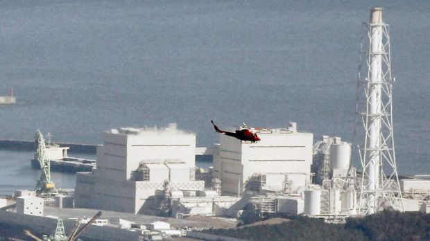 A helicopter flies past Japan's Fukushima Daiichi No.1 Nuclear reactor in March, 2011.