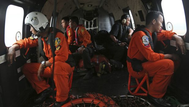 Hope: Indonesia air force members during a search operation for the missing plane.