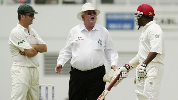 Umpire David Shepherd comes between Steve Waugh and Brian Lara in 2003.