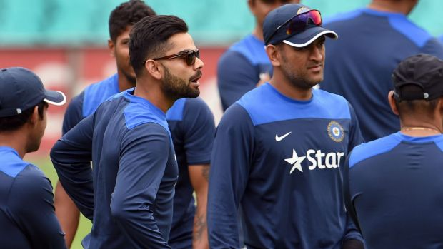 The present and the past: Virat Kohli and M.S. Dhoni at the SCG on Monday.