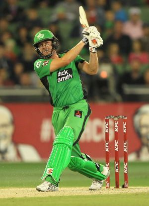 James Faulkner hits a six during the BBL game against Sydney Sixers at the MCG on Monday night.