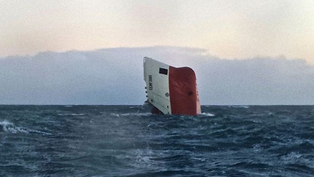 Eight missing ... Cypriot-registered cargo vessel Cemfjord slips into the sea some 24 kilometres from Wick in northeast ...