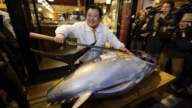 Sushi anyone? ... Kiyoshi Kimura, President of Kiyomura K.K., poses with the 180-kilogram tuna - which sold for 4.51 ...