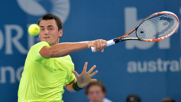 Straight-sets winner: Bernard Tomic plays a forehand against American Sam Querrey during day two of the 2015 Brisbane ...