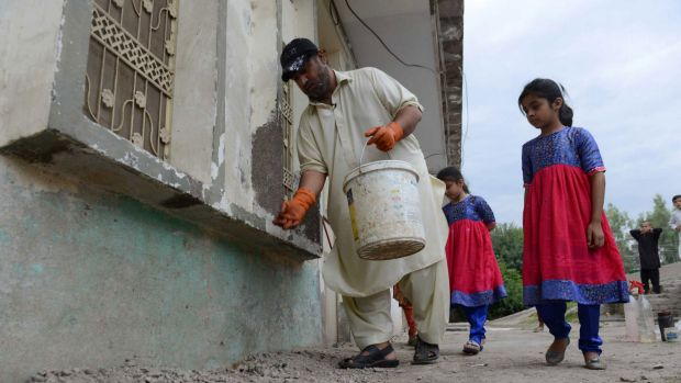 Setting the trap: Ahmad is often accompanied by his daughters during his rat-hunting.
