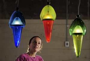 Curator of the GlassX Design exhibition at the Canberra Glassworks, Magda Keaney, with one of the exhibits, <i>Studies ...