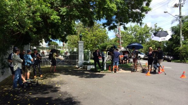 Journalists wait for Premier Campbell Newman outside Government House.