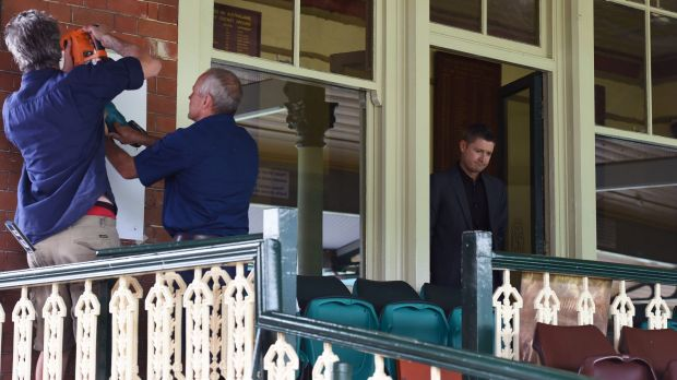 Michael Clarke stands by as the plaque for Phillip Hughes is put up at the SCG.