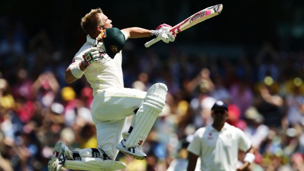Jump for joy: In typical style, David Warner celebrates his century at the SCG.
