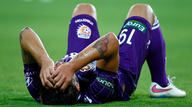 Perth Glory's Joshua Risdon takes a breather during his side's loss to Adelaide.