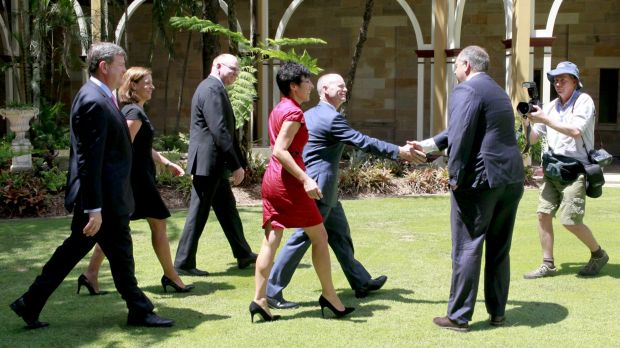 Premier Campbell Newman departs a press conference after announcing a state election for Queensland.