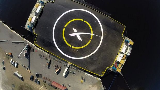 X marks the landing spot ... SpaceX's  'autonomous spaceport drone ship', a landing barge which measures 91 by 52 metres ...