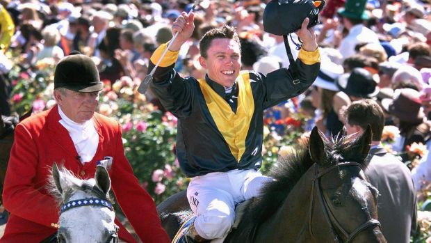Career highlight: Chris Munce celebrates his 1998 Melbourne Cup triumph on Jezabeel.