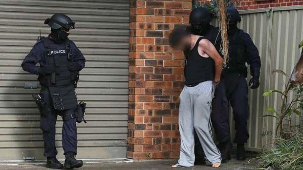 Raid: A 24-year-old man was arrested on Wednesday morning over the alleged murder of 20-year-old Dane McNeill.