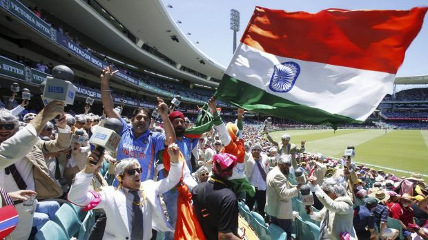 United in cricket: The Swami army and the 'Richies' dance together on day two of the Sydney Test.