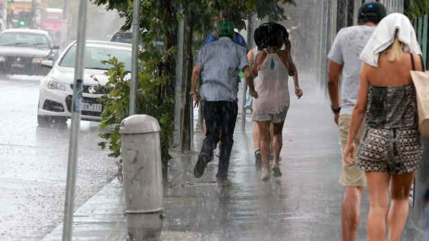 Heavy rain catches people by surprise in St Kilda.