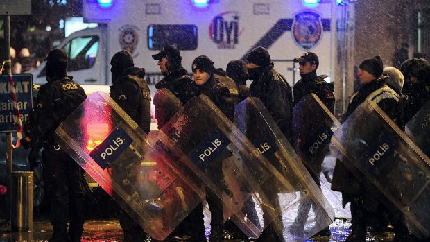 Riot police officers stand guard. The attack occurred in the Sultan Ahmet district, a popular tourist destination.