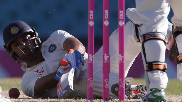 Down but not out: Rohit Sharma just about managed to protect his wicket as India dug in