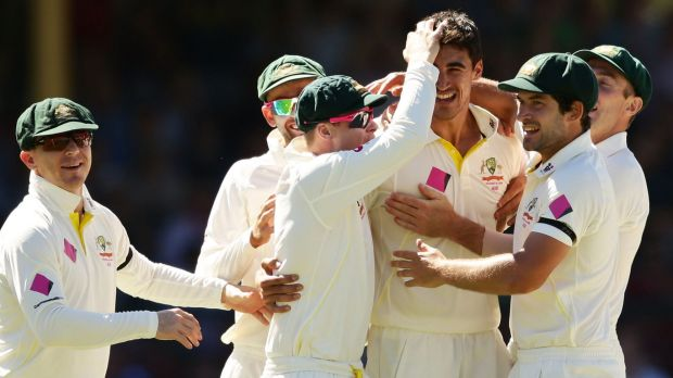 Well earned: Mitchell Starc celebrates the wicket of India's Murali Vijay.
