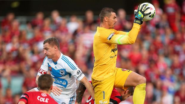 Safe pair of hands: Ante Covic flies above the pack to secure the ball in Tuesday's 2-1 loss to Melbourne Victory.