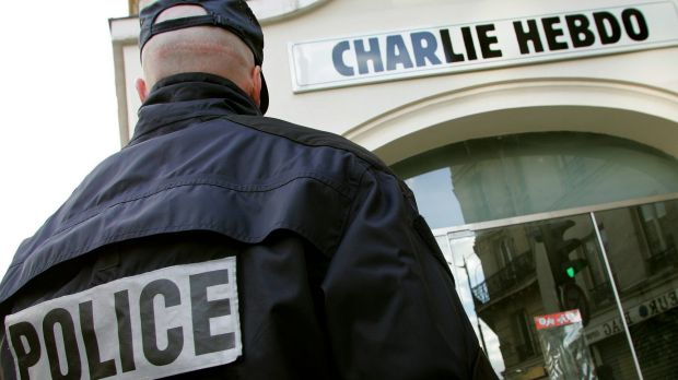 A policeman stands guard outside the French satirical weekly <i>Charlie Hebdo</i> in Paris in this February 9, 2006 file ...
