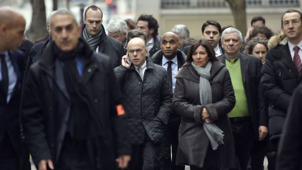 Fench Interior Minister Bernard Cazeneuve and Paris Mayor Anne Hidalgo arrive at the scene.